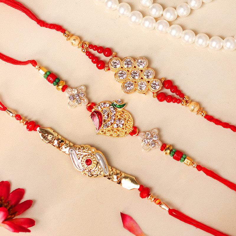 Touch Of Gold Rakhi Set - Set of 3 Designer Rakhis with Roli Chawal