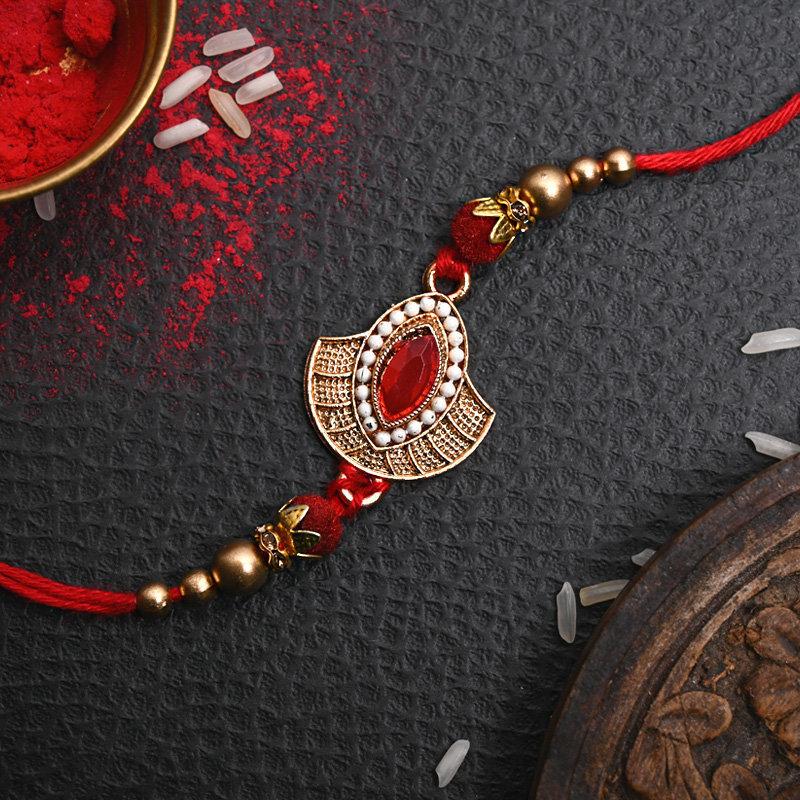 One Designer Rakhi - Traditional Red Metal Rakhi
