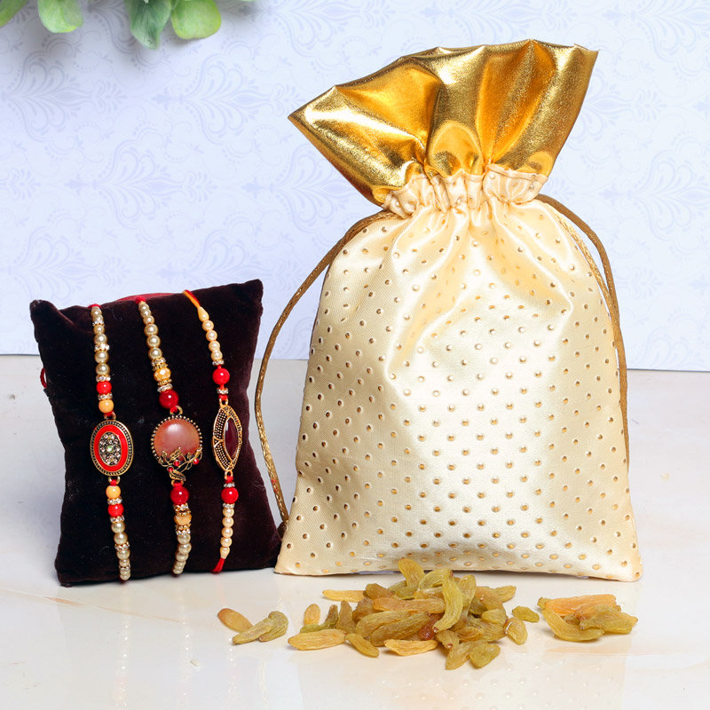Trendy Rakhi N Resin Combo - Set of 3 Designer Rakhi with Complimentary Roli and Chawal and 100gm Raisins in Cream Potli