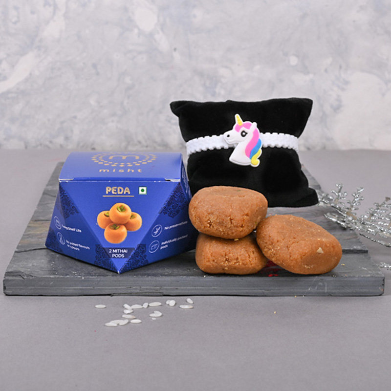 Get Delivery of Unicorn Rakhi with Peda Sweet