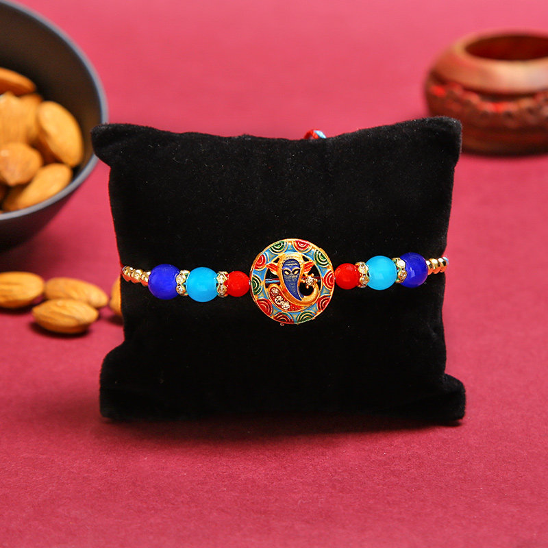 Vibrant Ganesha Rakhi N Almond Combo